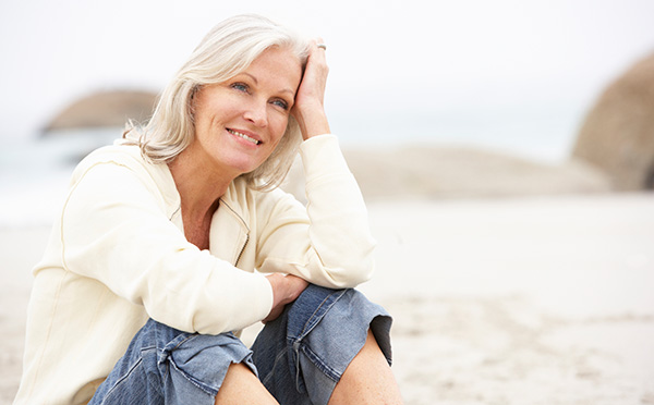 Woman sitting looking off smiling
